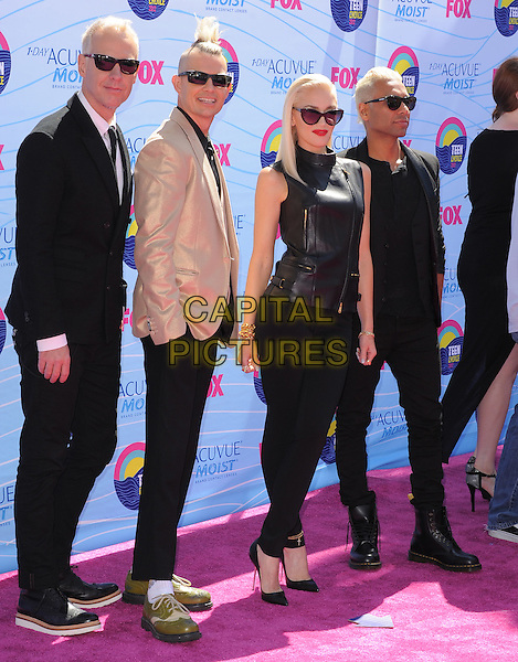 Tom Dumont, Adrian Young, Gwen Stefani & Tony Kanal of No Doubt.FOX's 2012 Teen Choice Awards held at The Gibson Ampitheatre in Universal City, California, USA..July 22nd, 2012          .full length black leather sunglasses shades red lipstick sleeveless zip zipper top trousers beige band group suit.CAP/RKE/DVS.©DVS/RockinExposures/Capital Pictures.