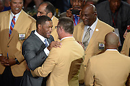 Canton, Ohio - August 1, 2014: 2014 Hall of Fame inductee and former NFL defensive-end Michael Strahan speaks to Howie Long during the Pro Football Hall of Fame's class of 2014 enshrinement dinner in Canton, Ohio,  August 1, 2014. Strahan was named to seven Pro Bowl teams and lead to NFL in sacks during the 2001 and 2003 seasons.  (Photo by Don Baxter/Media Images International)