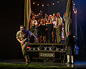"""Edinburgh, UK. 01.08.2019. The National Theatre of Great Britain presents """"Peter Gynt"""", by David Hare, directed by Jonathan Kent, at the Festival Theatre, as part of the Edinburgh International Festival. Picture shows: James McArdle (Peter Gynt), and the company. Photograph © Jane Hobson."""