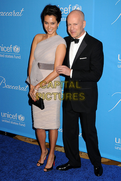 EMMA HEMING & BRUCE WILLIS.UNICEF Ball 2009 Honoring Jerry Weintraub held at the Beverly Wilshire Hotel, Beverly Hills, California, USA..December 10th, 2009.full length dress sash waist tux tuxedo black white bow tie beige purple one shoulder married husband wife hemming hair up clutch bag.CAP/ADM/BP.©Byron Purvis/AdMedia/Capital Pictures.