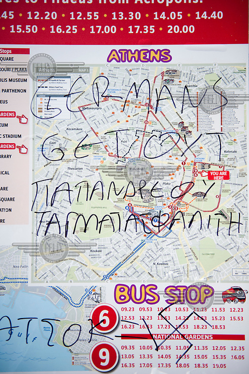 Anti German graffiti at a bus stop outside the Greek Parliament in Amalias Avenue, Athens.