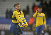 Leeds United's Ezgjan Alioski removes his shirt to give to a fan at the final whistle<br /> <br /> Photographer Stephen White/CameraSport<br /> <br /> The EFL Sky Bet Championship - Bolton Wanderers v Leeds United - Saturday 15th December 2018 - University of Bolton Stadium - Bolton<br /> <br /> World Copyright &copy; 2018 CameraSport. All rights reserved. 43 Linden Ave. Countesthorpe. Leicester. England. LE8 5PG - Tel: +44 (0) 116 277 4147 - admin@camerasport.com - www.camerasport.com