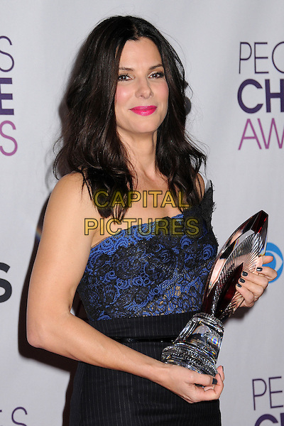 Sandra Bullock.People's Choice Awards 2013 - Press Room held at Nokia Theatre L.A. Live, Los Angeles, California, USA..January 9th, 2013.half length blue lace strapless top black skirt award trophy winner pinstripe pink lipstick .CAP/ADM/BP.©Byron Purvis/AdMedia/Capital Pictures.