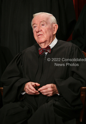 Washington, DC - September 29, 2009 -- Associate Justice of the United States Supreme Court John Paul Stevens poses for a photo during a photo-op at the U.S. Supreme Court in Washington, D.C. on Tuesday, September 29, 2009..Credit: Gary Fabiano / Pool via CNP