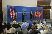 United States Secretary of Defense Donald H. Rumsfeld (left) and Macedonian Minister of Defense Vlado Buckovski addresses reporters during a joint press conference in Skopje, Macedonia, on October 11, 2004.  Rumsfeld is in Skopje to attend a bi-lateral meeting with Macedonia officials. <br /> Mandatory Credit: James M. Bowman / DoD via CNP