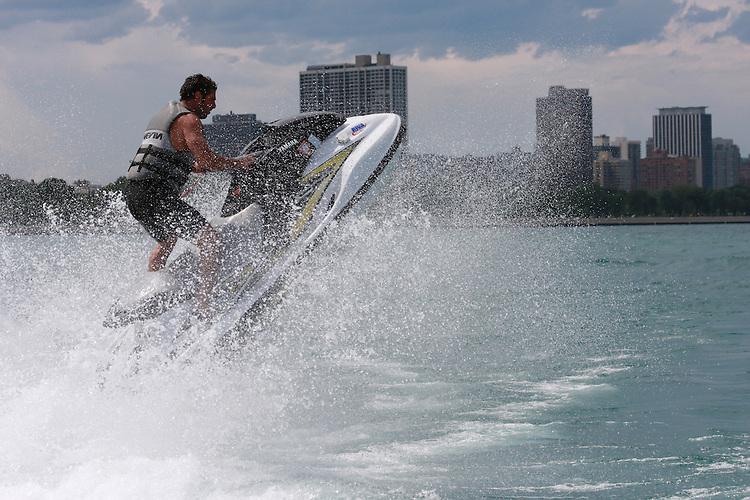 Man on waverunner jumping wake
