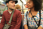Young interracial couple on the Metro train, Paris, France.