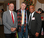Waterbury, CT 120717MK13 (from left) Steve Repka, Billy Duyer and Desmond Mahario, director of finance and human resources, gathered for the Waterbury Youth Services, Inc. Santa's Workshop at The Country Club of Waterbury. The event helps raise funds to make the holiday season memorable for children in need Michael Kabelka / Republican-American
