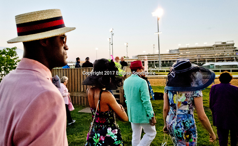 LOUISVILLE, KENTUCKY - MAY 02: Models head trackside to show of Derby fashion during Kentucky Derby and Oaks preparations at Churchill Downs on May 2, 2017 in Louisville, Kentucky. (Photo by Scott Serio/Eclipse Sportswire/Getty Images)