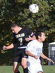 BEACON FALLS  CT. - 15 October 2019-101519SV12- #7 Devon Polletta of Woodland High and #18 Zach Guilherme of Oxford High go up to head a ball during NVL soccer action in Beacon Falls Tuesday. <br />Steven Valenti Republican-American