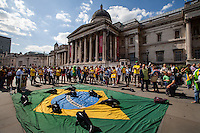 "London, 12/06/2014. Today, on the day of the opening ceremony of the 20th World Cup of Football in Sao Paolo (Brasil), a group of Brasilian people held a demonstration in Trafalgar Square to raise awareness of the problems that are still affecting their country (see photo captions) and in support and solidarity with the protests currently happening in Brasil. Meanwhile, the official ""Brazil Day"" organised by the Mayor of London was held without disruption in the main square."