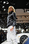 A model poses in a fashion show at the Lamborghini showroom at the Detroit Auto Show in Detroit, Michigan on January 12, 2009.