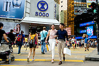 HONG KONG - MAY 04: Patricia Szeto and Jonathan Lui cross the street among a crowd of shoppers in front of Sogo shopping mall in Causeway Bay district, on May 4, in Hong Kong. (Photo by Lucas Schifres/Pictobank)