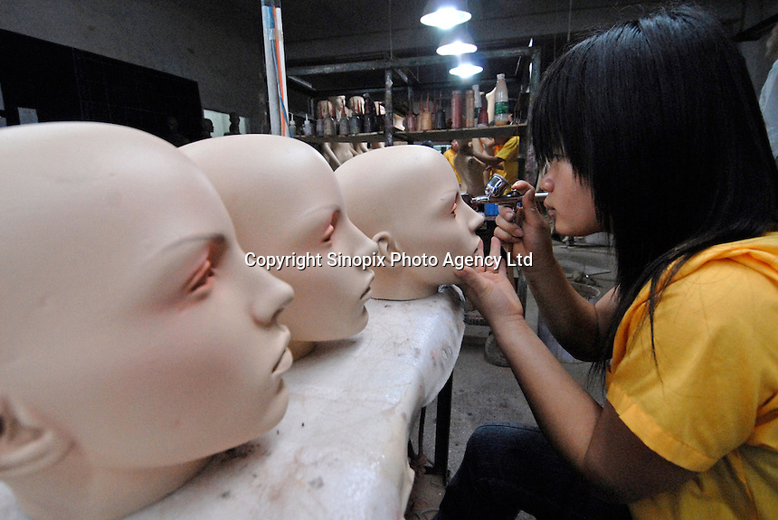 Gia Mannequin factory in Dongguan, China. The process of mannequin manufacturing involves the use of toxic cancer causing resin and the use of fibre glass that creates a poisonous dust. The workers are paid higher wages to work in such conditions..12 Jun 2007