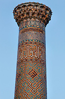 "Detail of minaret, Sher-Dor Madrasah, 1619-36, Samarkand, Uzbekistan, pictured on July 15, 2010, in the afternoon. The Sher-Dor Madrasah, commissioned by Yalangtush Bakhodur as part of the Registan ensemble, and designed by Abdujabor, takes its name, ""Having Tigers"", from the double mosaic (restored in the 20th century) on the tympans of the portal arch showing suns and tigers attacking deer. Samarkand, a city on the Silk Road, founded as Afrosiab in the 7th century BC, is a meeting point for the world's cultures. Its most important development was in the Timurid period, 14th to 15th centuries. Picture by Manuel Cohen."