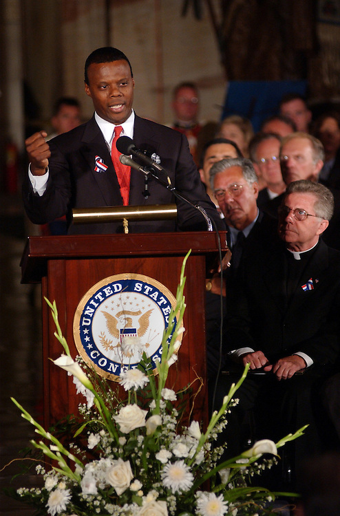 3vigil091301 -- At a prayer vigil held Wednesday in the Rotunda to honor those killed in terrorist, Rep. J.C. Watts, R-Okla., address the crowd.