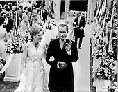 "Washington, DC - June 12, 1971 -- United States President Richard M. Nixon, right, and first lady Pat Nixon, left, give the ""A-OK"" sign as they walk down the aisle of the Rose Garden at the White House in Washington, D.C. after their daughter Tricia's wedding on Saturday, June 12, 1971.  More than 400 friends and guests braved intermittent rain to attend the ceremony..Credit: Pool via CNP"