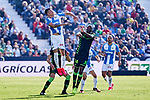 Jose Arnaiz of CD Leganes and William Carvalho of Betis Balompie during La Liga match between CD Leganes and Real Betis Balompie at Butarque Stadium in Leganes, Spain. February 16, 2020. (ALTERPHOTOS/A. Perez Meca)