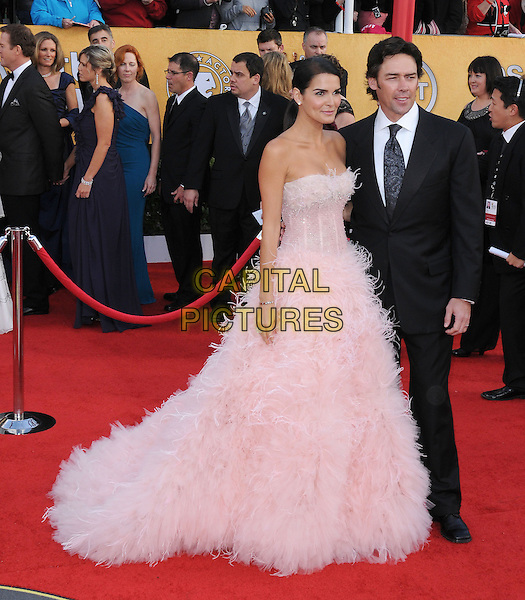 ANGIE HARMON & JASON SEHORN .at the 17th Screen Actors Guild Awards held at The Shrine Auditorium in Los Angeles, California, USA, .January 30th 2011..SAG Sags arrivals  full length strapless pink dress gown long maxi feathers feather feathered           couple married husband wife suit tie black                                                          .CAP/RKE/DVS.©DVS/RockinExposures/Capital Pictures.