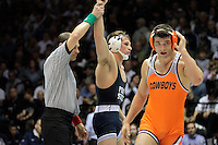 STATE COLLEGE, PA - FEBRUARY 16: David Taylor of the Penn State Nittany Lions gets his hand raised by the referee after winning his 165 pound match against Tyler Caldwell of the Oklahoma State Cowboys on February 16, 2014 at Rec Hall on the campus of Penn State University in State College, Pennsylvania. Penn State won 23-12. (Photo by Hunter Martin/Getty Images) *** Local Caption *** David Taylor;Tyler Caldwell