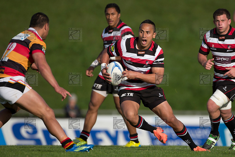 Tony Pulu looks to step back inside Joe Perawiti during the ITM Cup rugby game between Counties Manukau Steelers and Waikato, played at ECOLight Stadium Pukekohe on Saturday 6th of October 2012. Waikato won the game 32 - 28.