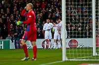 Wednesday 05 March 2014<br /> Pictured: Wales team mates celebrate Gareth Bale's second half goal <br /> Re: International friendly Wales v Iceland at the Cardiff City Stadium, Cardiff,Wales UK
