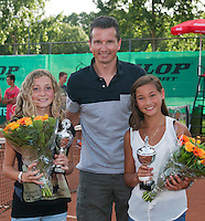 August 9, 2014, Netherlands, Rotterdam, TV Victoria, Tennis, National Junior Championships, NJK,  Prize giving, Richard Krajicek with Emma Goedkoop and Roos van Reek, runners up girls  doubles 14 years<br /> Photo: Tennisimages/Henk Koster