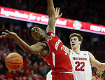 Nebraska Cornhuskers center Jordy Tshimanga (32) follows a loose ball as Wisconsin Badgers forward Ethan Happ (22) defends at the Kohl Center. Mandatory Credit: Mary Langenfeld-USA TODAY Sports
