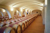 The barrel oak aging cellar. Chateau Haut Chaigneau, Lalande de Pomerol, Bordeaux, France