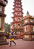 VIETNAM, Hanoi, a little girl running, Tran Quoc Pagoda in the background