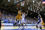 29 December 2014: Toledo's Julius Brown (20) shoots over Duke's Marshall Plumlee (40). The Duke University Blue Devils hosted the University of Toledo Rockets at Cameron Indoor Stadium in Durham, North Carolina in a 2014-16 NCAA Men's Basketball Division I game. Duke won the game 86-69.