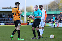 Referee, Mr Graham Salisbury enjoys a joke with James Pearson of Barnet (left) before booking hi for hand ball during the Sky Bet League 2 match between Barnet and Luton Town at The Hive, London, England on 28 March 2016. Photo by David Horn.