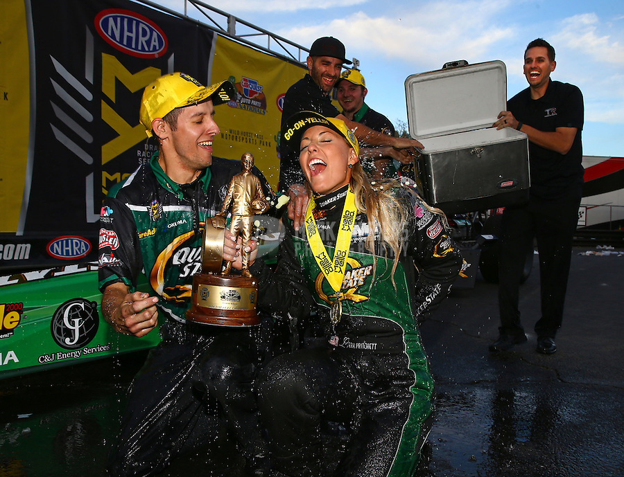 Feb 28, 2016; Chandler, AZ, USA; NHRA top fuel driver Leah Pritchett is doused with water by crew members as she celebrates after winning the Carquest Nationals at Wild Horse Pass Motorsports Park. Mandatory Credit: Mark J. Rebilas-