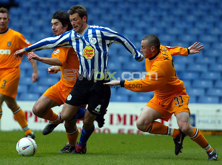 Pix, Shaun Flannery/SWpix. Nationwide League Division One..Sheffield Wednesday v Grimsby Town, 19/3/2003..COPYRIGHT PICTURE>>SIMON WILKINSON>>01943 - 436649>>..Wednesday's Paul McLaren finds away past Grimsby's Richard Hughes & Michael Keane.