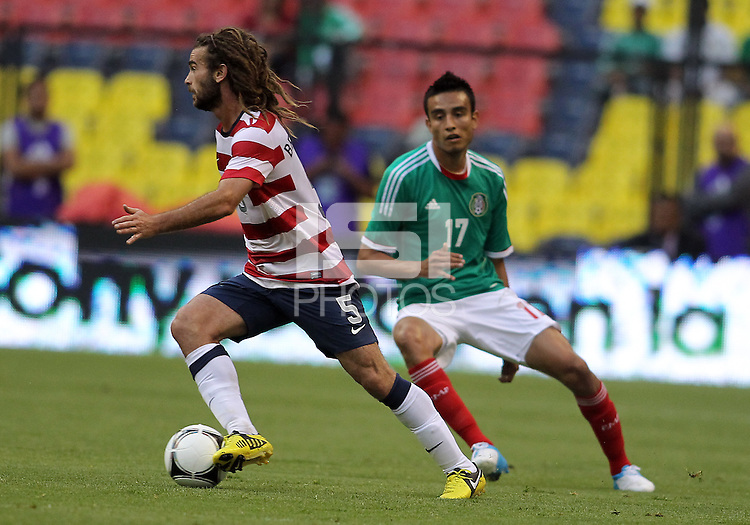 MEXICO CITY, MEXICO - AUGUST 15, 2012:  Kyle Beckerman (5) of the USA MNT pulls away from Jesus Zavala (17) of  Mexico during an international friendly match at Azteca Stadium, in Mexico City, Mexico on August 15. USA won 1-0.