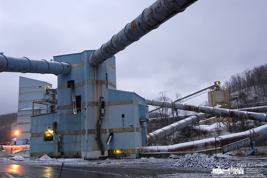 A light cover of snow lays Friday, Jan. 6, 2006, across some of the cleaning facility buildings at the Buckhannon, WV, Sago mine where 12 miners died in an explosion. (Gary Gardiner/EyePush Newsphotos)<br />