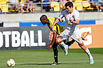 Brisbane Roar's James Donachie, right and Phoenix's Roly Bonevacia, left, jostle for position as they chase the ball in the A-League football match at Westpac Stadium, Wellington, New Zealand, Sunday, January 04, 2015. Credit: Dean Pemberton