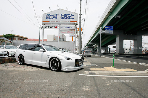 A customized Nissan M35 Stagea wagon with a R35 GT-R front-end conversion
