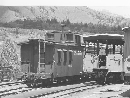 Long caboose #0540 in the yard.<br /> D&amp;RGW  Silverton Branch, CO