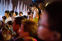 People gather to watch the nightly musical fountain and light show outside the Dayan Pagoda (Big Wild Goose Pagoda) in Xian, Shaanxi, China.