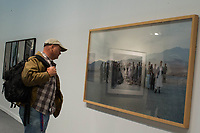 NEW YORK, NY - MARCH 30: A man looks at a picture as people attend the 37th edition of The Photography Show, presented by AIPAD on March 30, 2017 in Manhattan, New York. One of the world's most prestigious annual photography events, The Photography Show is the longest-running and foremost exhibition dedicated to the photographic medium, offering a wide range of museum-quality work, including contemporary, modern, and 19th-century photographs as well as photo-based art, video, and new media. Photo by VIEWpress/Eduardo MunozAlvarez