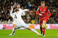 Real Madrid´s Sergio Ramos and Sevilla's Gerard Lazaro during 2014-15 La Liga match between Real Madrid and Sevilla at Santiago Bernabeu stadium in Alcorcon, Madrid, Spain. February 04, 2015. (ALTERPHOTOS/Luis Fernandez) /NORTEphoto.com