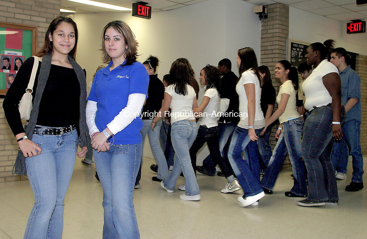 WATERBURY, CT -05 DECEMBER 2007 -120507DA002- Sophomores students of W.F. Kaynor Technical High School in Waterbury, Jessica Bonilla, left and Stephanie Dias pose Wednesday during a &ldquo;Blue Jeans for the Bonilla Family Day&rdquo;. Dias came up with the idea to help raise money for Bonilla and her family that lost everything in a fire on Thanksgiving Day. Students donated $3.00 for the opportunity to wear blue jeans to school and have collected $1,700.00 to go to Jessica&rsquo;s family. Students at Kaynor have been following a dress code/uniform that does not include jeans and felt this was a great way to raise funds to help the family get back on their feet.<br /> Darlene Douty/Republican-American