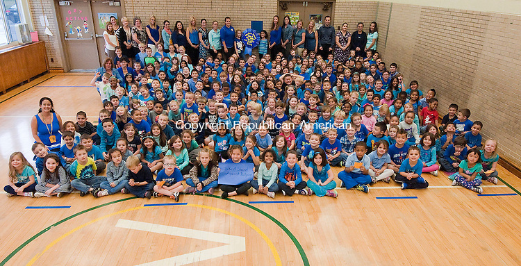 NAUGATUCK, CT-101614JS01- Students and staff at Western School in Naugatuck wore blue on Thursday in support of taking a stand against bullying. Along with wearing blue, each class had lessons related to bullying as well as donating a canned goods to benefit the Naugatuck Food Bank. <br />  Jim Shannon Republican-American