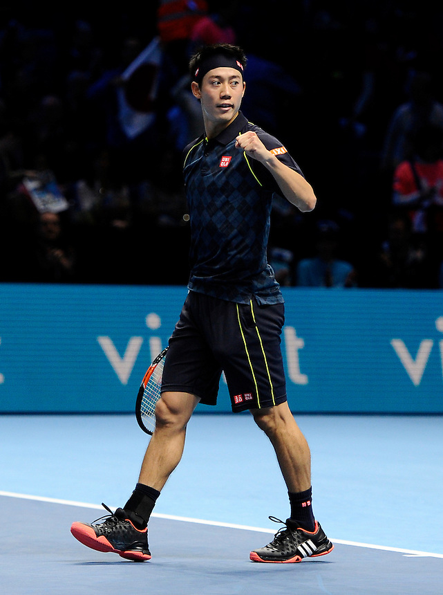 Kei Nishikori celebrates his victory over Tomas Berdych in their Stan Smith Group match today - Kei Nishikori def Tomas Berdych 7-5, 3-6, 6-3<br /> <br /> Photographer Ashley Western/CameraSport<br /> <br /> International Tennis - Barclays ATP World Tour Finals - O2 Arena - London - Day 3 - Tuesday 17th November 2015<br /> <br /> &copy; CameraSport - 43 Linden Ave. Countesthorpe. Leicester. England. LE8 5PG - Tel: +44 (0) 116 277 4147 - admin@camerasport.com - www.camerasport.com