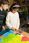 Education Elementary School New York grade 3 geography social studies female student working on map male student looking on vertical