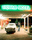 USA, Arizona, man standing by classic car at Wigwam motel