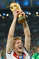 Andre Schurrle of Germany lifts the World Cup trophy after winning the 2014 final