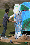 Doral Red Rock Academy student Denzel Barabaran,15, paints a Cadillac at the driving range at the Silver Oak Golf Course, in Carson City, Nev., on Sunday, April 8, 2018. The Las Vegas art students' work was a Carson City history theme. <br /> Photo by Cathleen Allison/Nevada Momentum