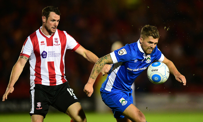 North Ferriby United's Ryan Kendall shields the ball from Lincoln City's Lee Beevers<br /> <br /> Photographer Chris Vaughan/CameraSport<br /> <br /> Football - Vanarama National League - Lincoln City v North Ferriby United - Tuesday 9th August 2016 - Sincil Bank - Lincoln<br /> <br /> &copy; CameraSport - 43 Linden Ave. Countesthorpe. Leicester. England. LE8 5PG - Tel: +44 (0) 116 277 4147 - admin@camerasport.com - www.camerasport.com